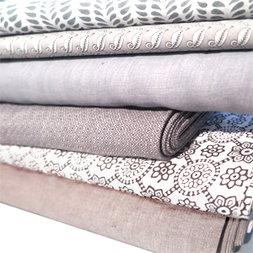 verschillende natuurlijke stoffen (oa. linnen, katoen, zijde) uni, bedrukt of jaquard